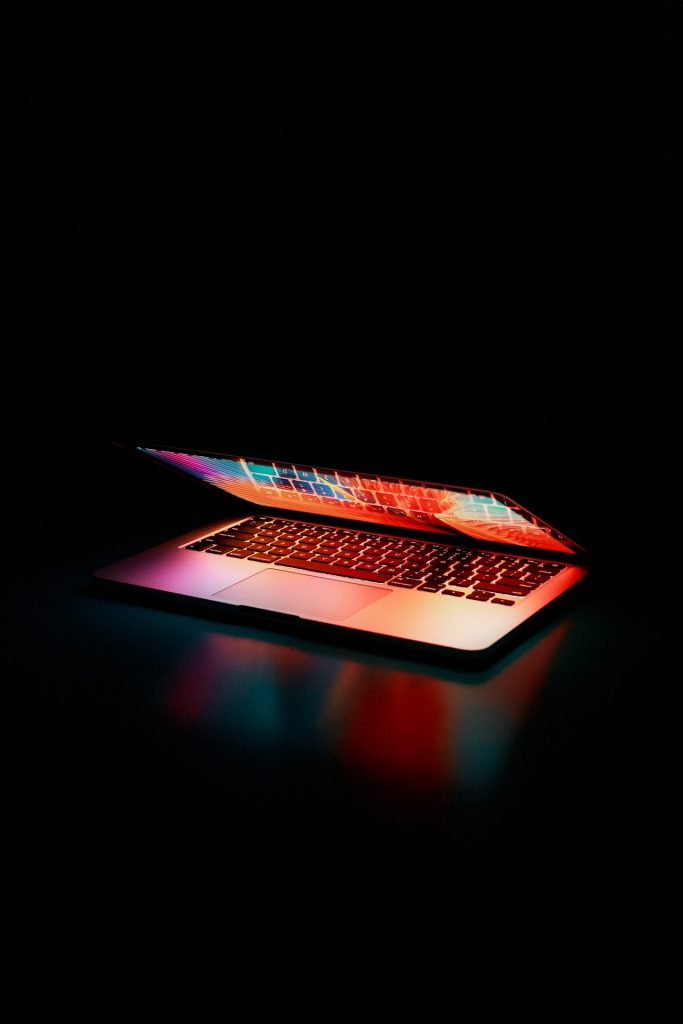 semi-opened-laptop-computer-turned-on-on-table